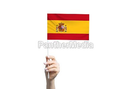 beautiful female hand holding spain flag
