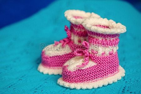small white pink childrens knitted booties