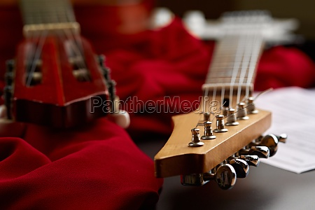 electric and classical acoustic guitar heads