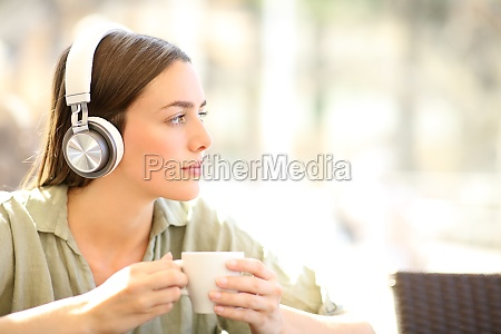 woman relaxing listening to music in