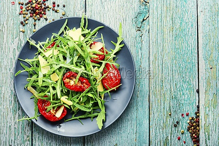 healthy salad with dried tomato and
