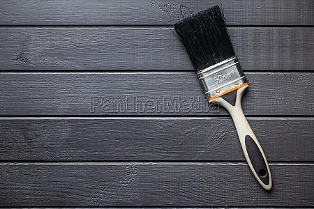 paint brush on black plank background