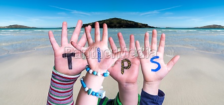 children hands building word tips ocean