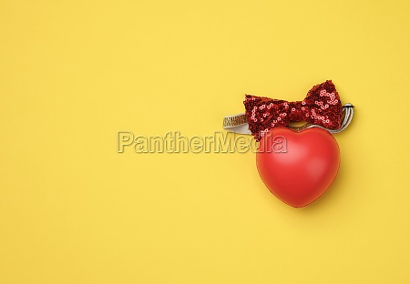 red rubber heart on a yellow