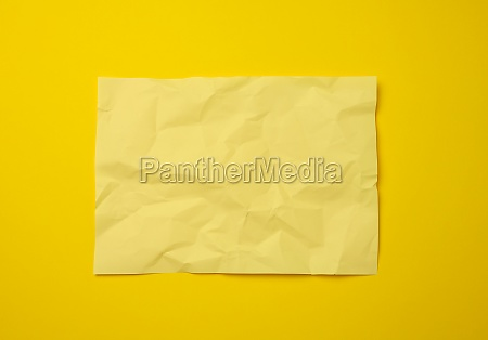 blank crumpled yellow sheet of paper