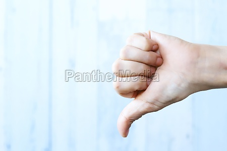 woman hand with thumb down gesture