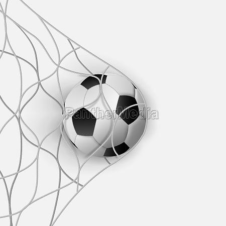 soccer ball in a soccer goal