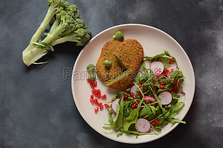 broccoli schnitzel served with pomegranate salad