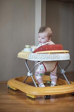 baby learning to walk in walker