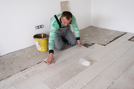 worker installing the ceramic wood effect