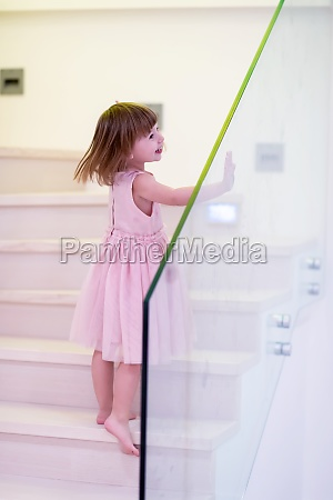 little girl playing on stairs at