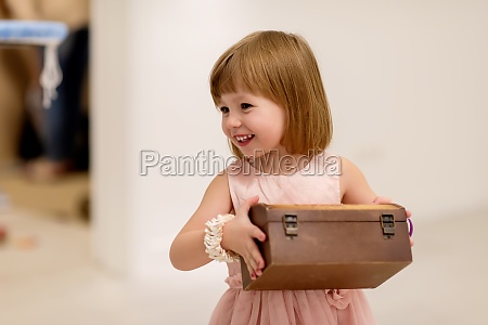 little girl enjoying while playing with