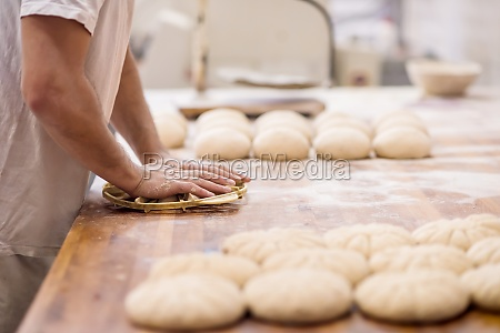 bakery worker preparing the dough