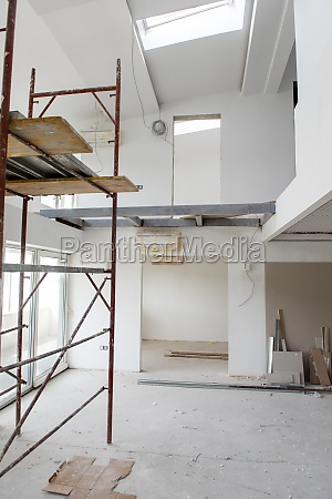 interior of construction site with scaffolding