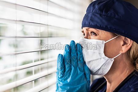 prayerful stressed female doctor or nurse