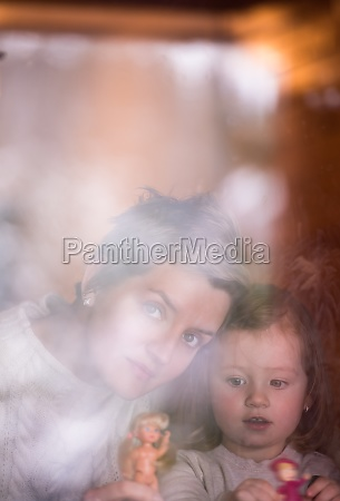 young mother and little cute daughter