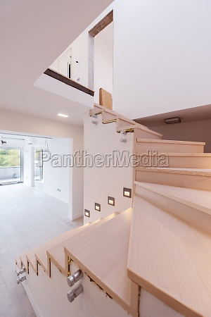 stylish interior with wooden stairs