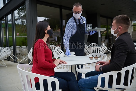 waiter with protective medical mask and