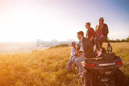 group of young people driving a