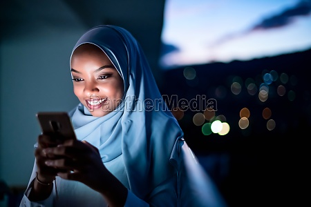 young muslim woman on street
