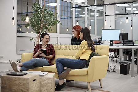 female friends discussion about project at