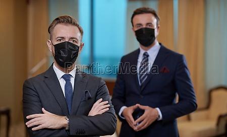 business team wearing crona virus protection