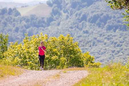 young woman jogging on sunny day