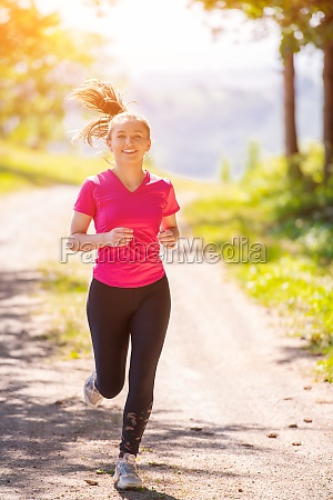woman jogging on sunny day at
