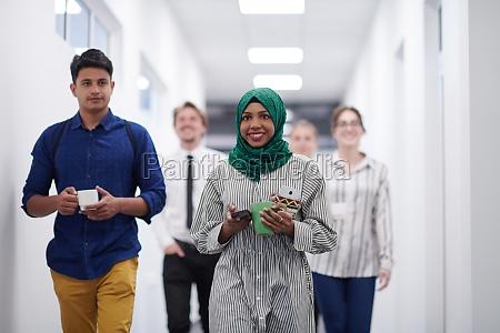 multi ethnic startup business team walking