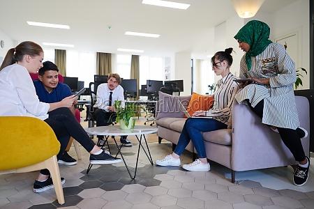 multiethnic startup business team having team