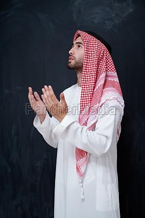 arabian man making traditional prayer to