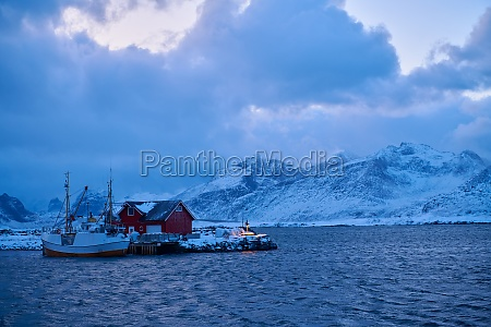 traditional norwegian fishermans cabins and boats