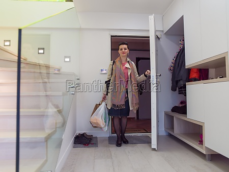 woman on stylish interior of apartment