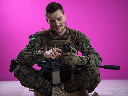 soldier using smartphone