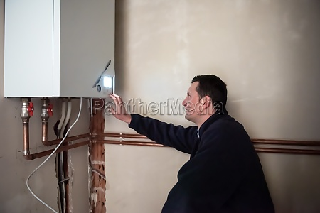 engineer checking technical data of heating
