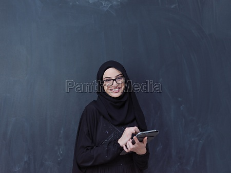 young muslim business woman using tablet