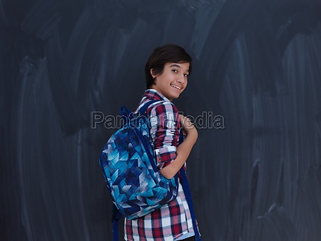 arab teenager with schoold backpack