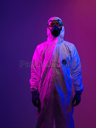 doctor wearing protective biological suit and