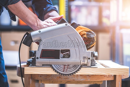 sawing wood in the garage home
