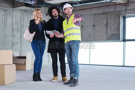 architect showing house design plans to