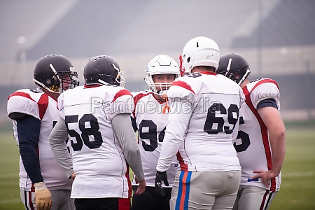 american football players discussing strategy