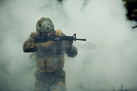 soldier in action aiming on