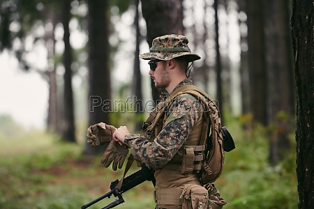 soldier preparing tactical and commpunication gear