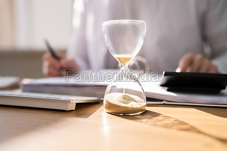 accountant calculating invoice bill in time