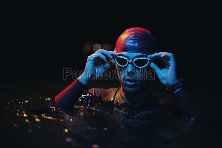 authentic triathlete swimmer having a break