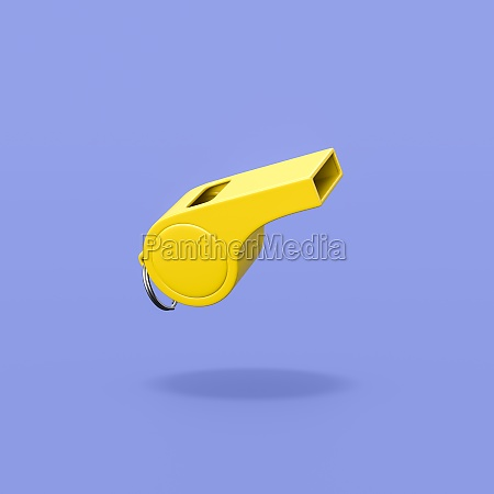 yellow plastic whistle on blue background