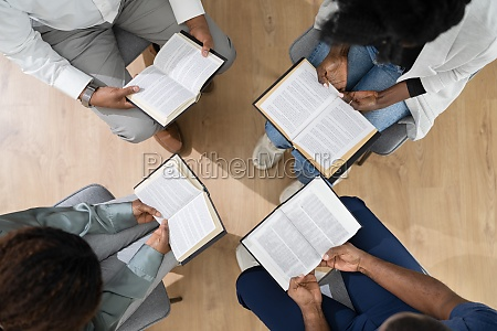 african group of people reading religious