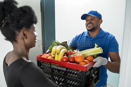 online order food delivery african man