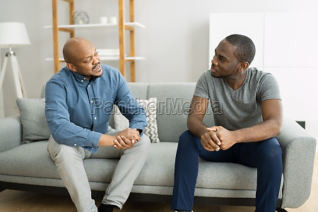 african family candid reunion chat
