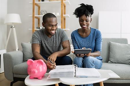 happy couple doing retire finances plan